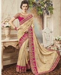 1. Light Cream pure silk sari 2. Adorned with exclusive embroidery and dori hand work border 3. Comes with a matching embroidered art silk unstitched blouse