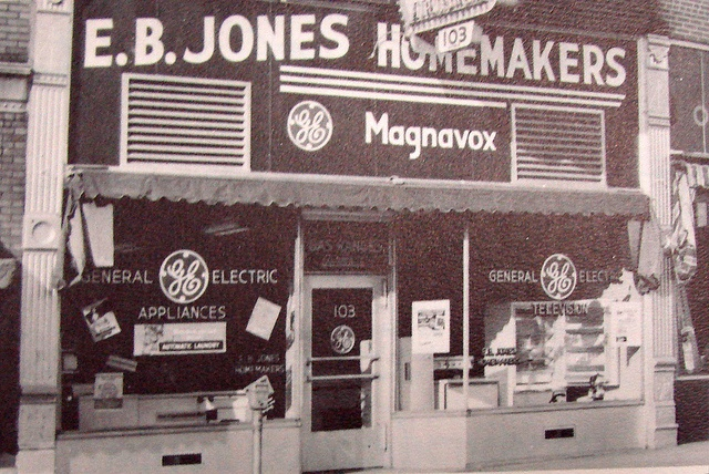 "E.B. Jones Homemakers 1957   For the ""Best Deal"", the biggest trade in town, see the rest, then see E.B. JONES HOMEMAKERS INC. 103 West Main, Belleville, Illinois [pictured] AD-4-4913 11th & Illinois Ave., East St. Louis UP-5-2600  (Ad copy accompanying photo in Academy of Notre Dame yearbook, 1957)"