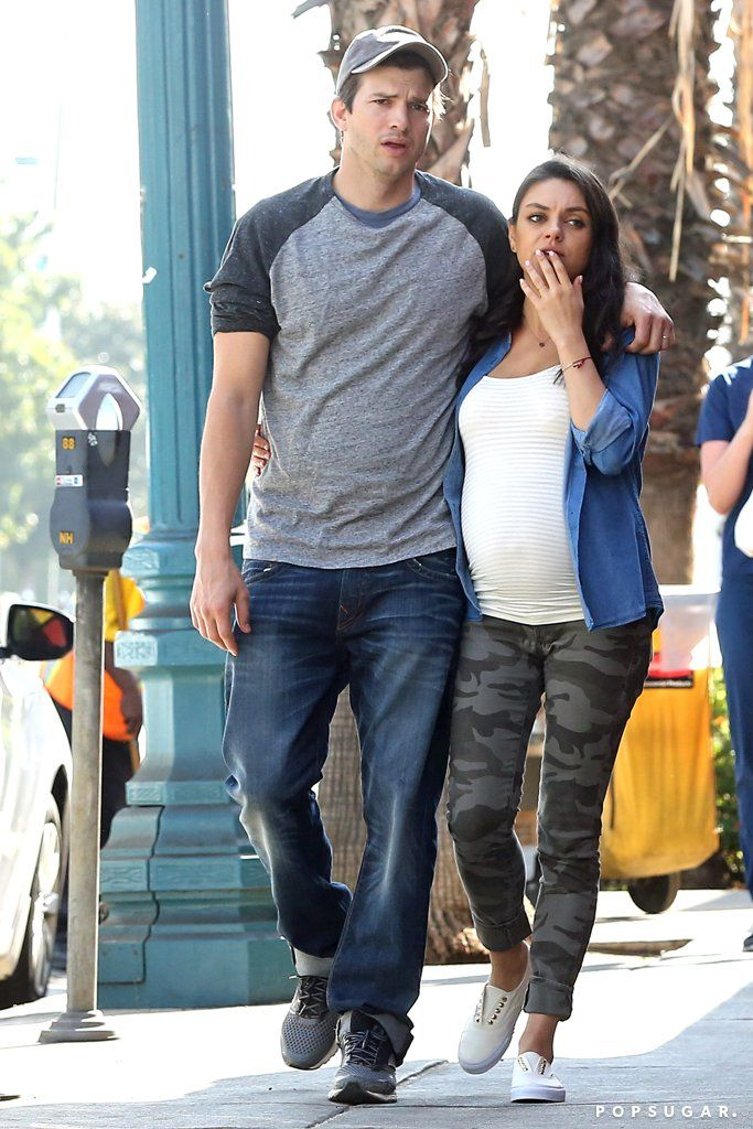 Ashton Kutcher and Mila Kunis Wrap Their Arms Around Each Other During a Sunny…
