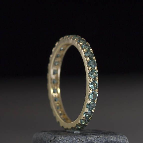 Gold eternity ring handmade to perfection and an artist`s touch around each stone. Beautifully made in your choice of precious metal and set with Blue Emeralds 2.25 mm and 0.04 points each. A wonderful deep color with a good amount of sparkle renders this ring a true joy to own and wear each