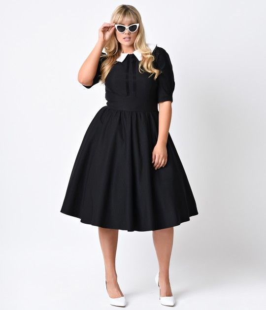 Something to hold onto that hourglass, gals? The very best in plus size vintage clothing, The Stop Staring! Almira Dress is a crisp black swingin' frock with stunning plus retro dress sensibility. Crafted in a 1950s inspired A-line silhouette and boasting