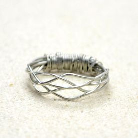 : A new addition to wire ring category! Details of weaving wires are completely shown in this 5-strand woven wire ring tutorial.