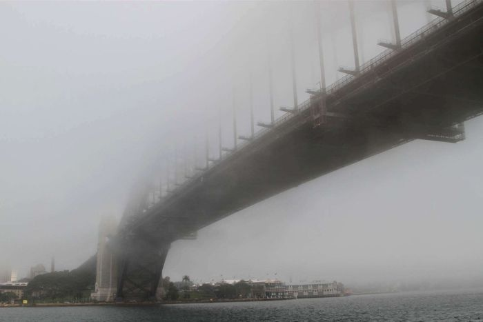 Fog shrouds the Sydney Harbour Bridge.