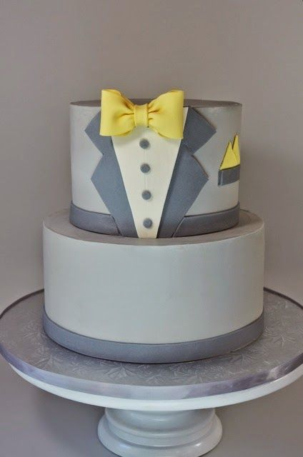 Buttercream tux cake with fondant accents on Cup a Dee Cakes.