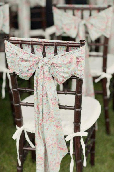 @Corrie Traxler Traxler Schuckhardt. To cover the plastic chairs, over the regular chair cover, you can add a vintage fabric sash