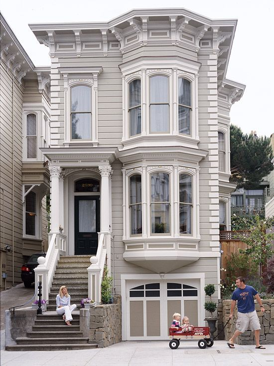 New windows and a fresh coat of paint gave this revamped rowhouse a new look. LOVE a great SF home redo!