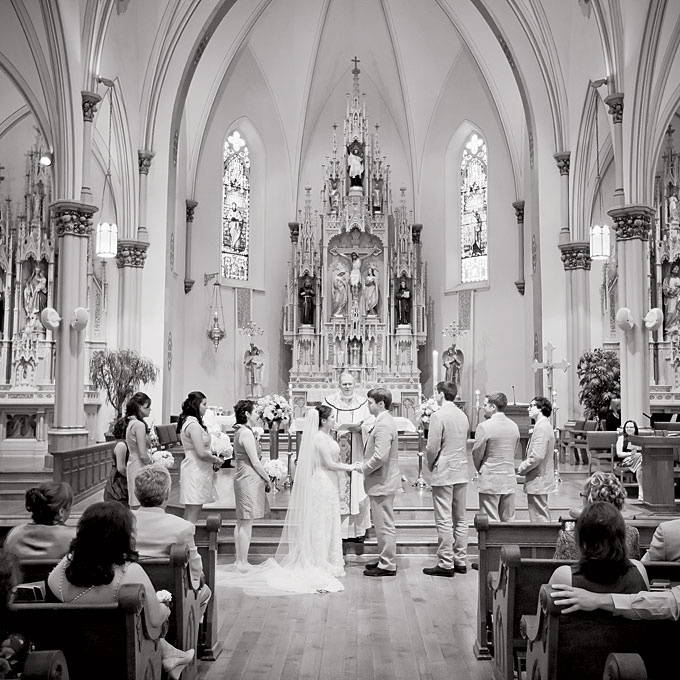 """""""The church is so beautiful and didn't need much additional decor,"""" says the bride. Weber Photography."""