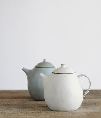Beautiful teapots made in Japan by Jurgen Lehl.     These beauties are molded from gourds and coconuts in shapes that are subtly altered by the firing process making each one unique.
