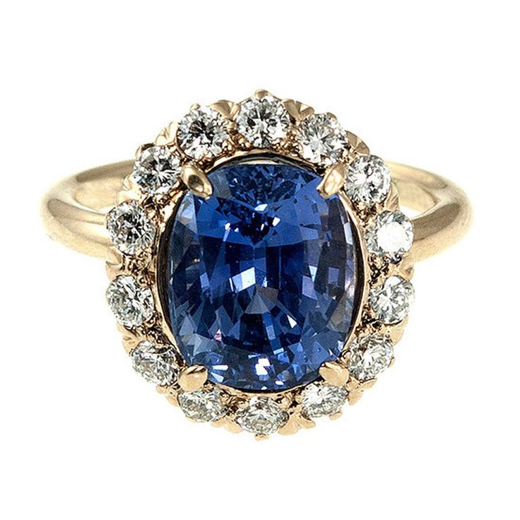 1940's Tiffany & Co 14k yellow gold ring with fine near colorless near flawless full cut diamonds surrounding a very special one of a kind super bright medium slightly purplish blue all natural no heat 4.90ct cushion sapphire with a step cut bottom and brilliant top.