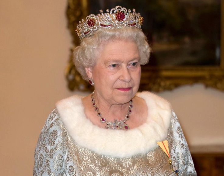 The British monarch looks resplendent in a glittering white and red crown while attending a 2008 banquet in Slovenia.