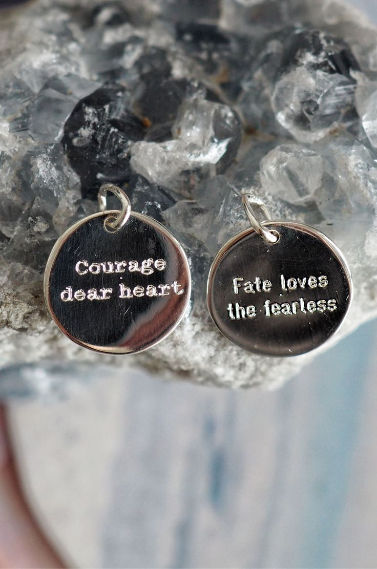 """Tiny minimalist sterling silver round pendants with simple font motivational saying """"Courage dear heart"""" and """"fate loves the fearless"""""""