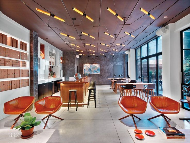 paired niels bendtsen swivel chairs atop pale gray polished concrete flooring in the lobby at the new york micro hotel arlo hudson square - Beaded Inset Hotel Decoration