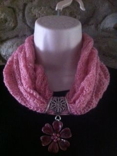 pink machine knitted necklace with pink flower pendant on silver bail