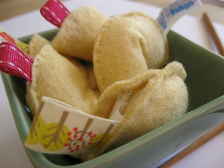 Hand made felt fortune cookies!  I made these using  Mollie Makes magazine as a guide.
