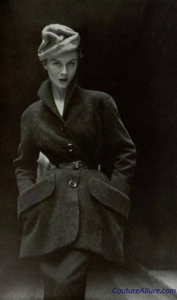 Who needs a handbag when you've got pockets like these?  Christian Dior gray wool suit, Fall 1950.