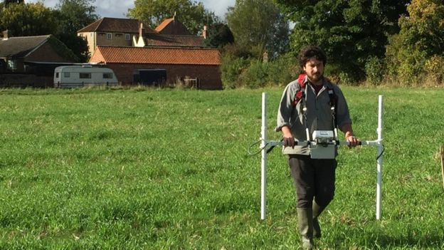 Sheffield doctoral student Pete Townend carries out geophysical and magnetometry surveys at the Little Carlton site