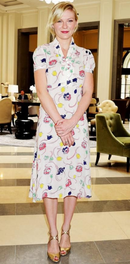 Look of the Day › June 23, 2011 WHAT SHE WORE Dunst headed to a Wimbledon match in a floral dress and gold stilettos.