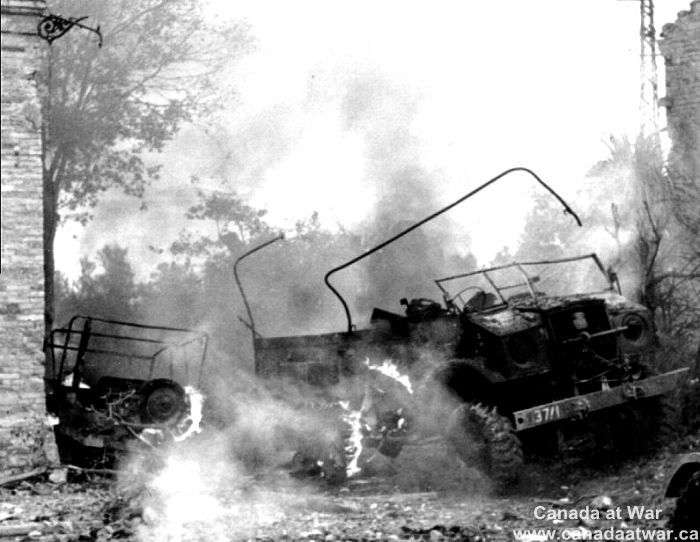 Ortona - During the fighting at Ortona, a Canadian truck burns after being set on fire by German mortar fire.