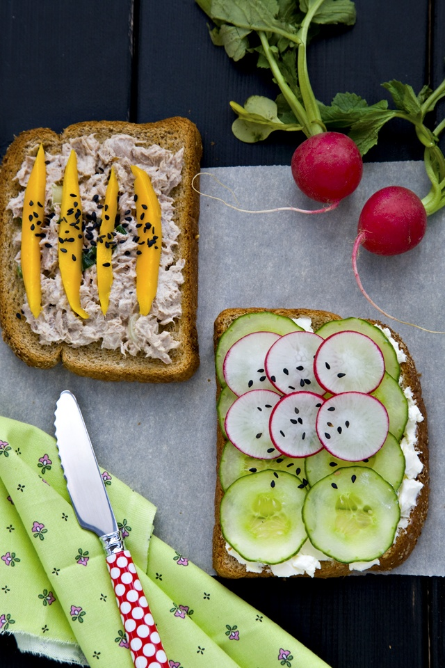 Tuna salad tartine with yuzu mayo and mango slices. The other one is a ...