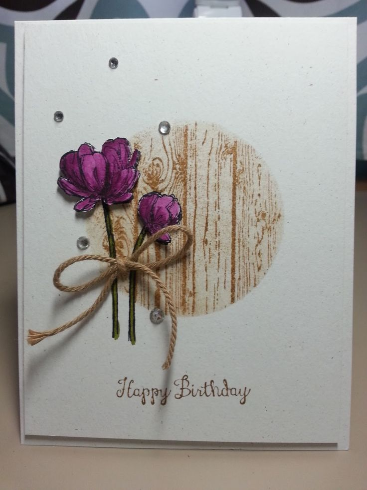 Simple masking technique with woodgrain stamp makes me think of a peeking hole in a fence on this handmade birthday card.  The flowers are beautifully colored in Blackberry Bliss and popped up for dimension.