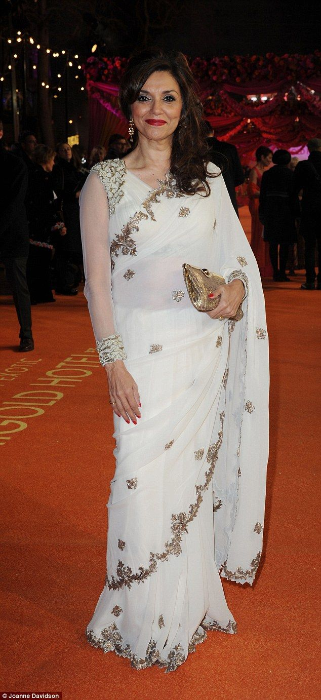 Chic: Her co-star Lillete Dubey looked incredible in a white sari with silver embellishmen...