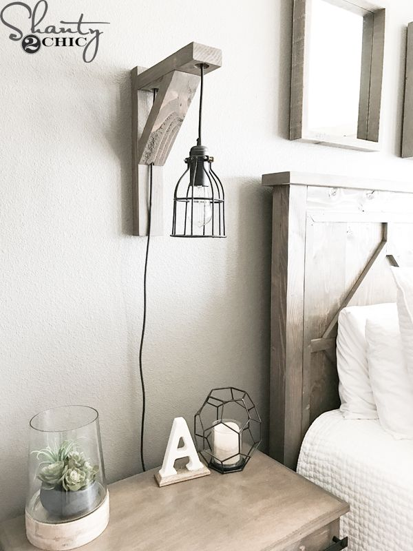 Build this DIY Rustic Corbel Light Sconce for $25! Creative bedroom lamp but perfect for so many spots in your home! Free plans at www.shanty-2-chic.com