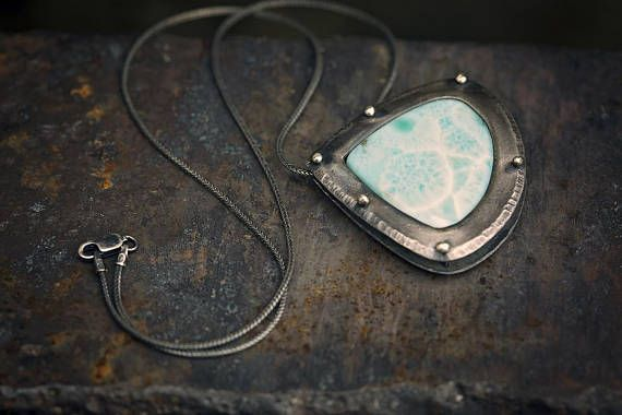 RARE Larimar + Sterling Silver Statement Necklace.  Larimar, a rare blue variety of the silicate mineral pectolite, is only found in the Dominican Republic.  AVAILABLE HERE ---> www.etsy.com/listing/541894944  ||  #uruzmetals #larimar #rare #unique #A+++ #sterlingsilver #silver #statementnecklace #necklacesofig #necklacesofinstagram #pectolite #scienceisbadass #aqua #blue #green #turquoise #stefiliasstone #teardrop #pendant #rivet #pagan #heathen #asatru