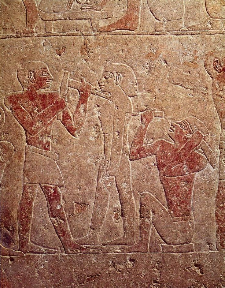Two Sculptors Working on a Statue – Saqqara (5th Dynasty: c. 2510-2460 BC) painted stone relief Cairo, Egyptian Museum