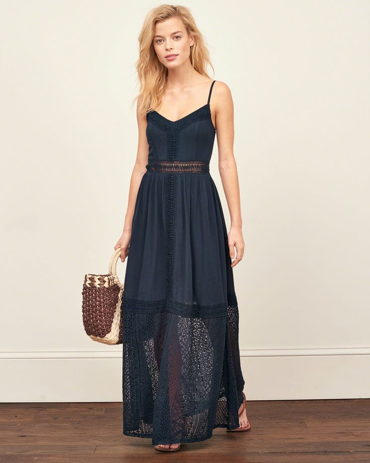 A statement-making maxi dress with pretty lace paneling, a v neckline and adjustable skinny straps, Imported
