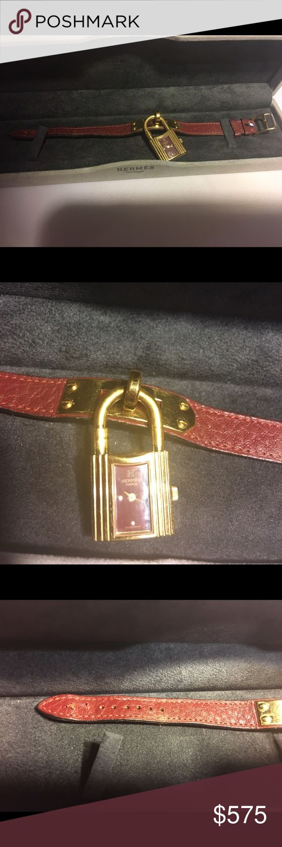 Hermes Rouge and Gold Plated Kelly Watch Quartz movement but needs service for new battery.  Comes with original case and box.  An extra hole was added to help fit 8 inch wrist.  Rouge leather band with gold plated detailing.  Authentic as always. Hermes Accessories Watches