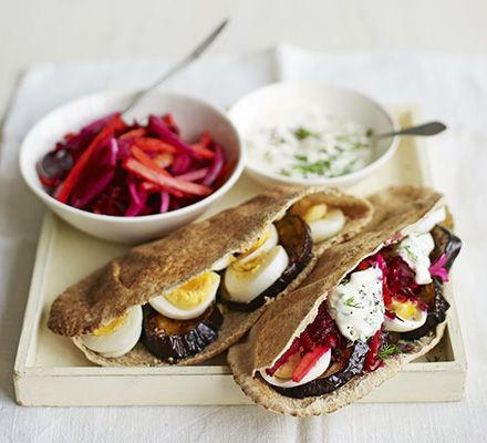 Cram wholemeal bread pockets with healthy aubergine, beetroot and carrot, then add a garlic and dill yogurt and eggs