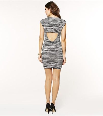 You'll certainly turn heads with this cut out back body con dress!