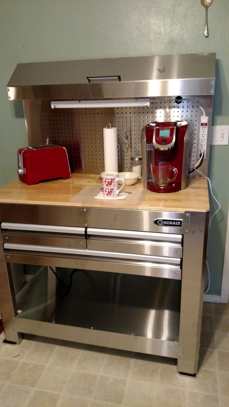 I used a kobalt workbench from lowes to make a coffee bar in my small kitchen. The top opens, has 3 drawers and is stainless steel.