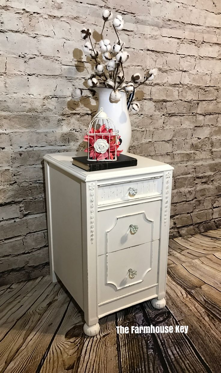 """This romantic three drawer antique table is now available.  Solid hardwoods, raised moldings,  fluting, carved feet, and appliqués and crystal pulls give this piece charm. Use her in the bedroom, tuck in a bathroom, or next to your favorite arm chair. Dimensions are 15""""'Wx25""""Hx18""""'D $165.00 *Delivery available for an additional fee"""