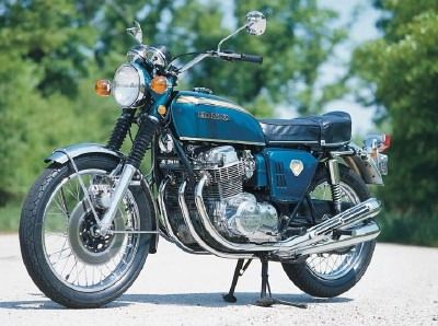 At the heart of the Honda CB750 motorcycle was an inline four-cylinder engine with single overhead cam, four carburetors, prominent four-into-four exhaust, and 67 horsepower at 8000 rpm.