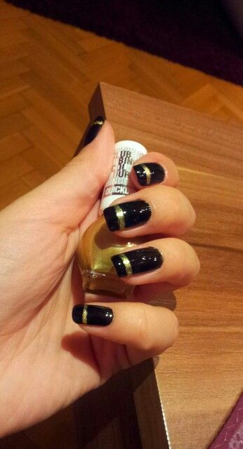 Black with gold line nails