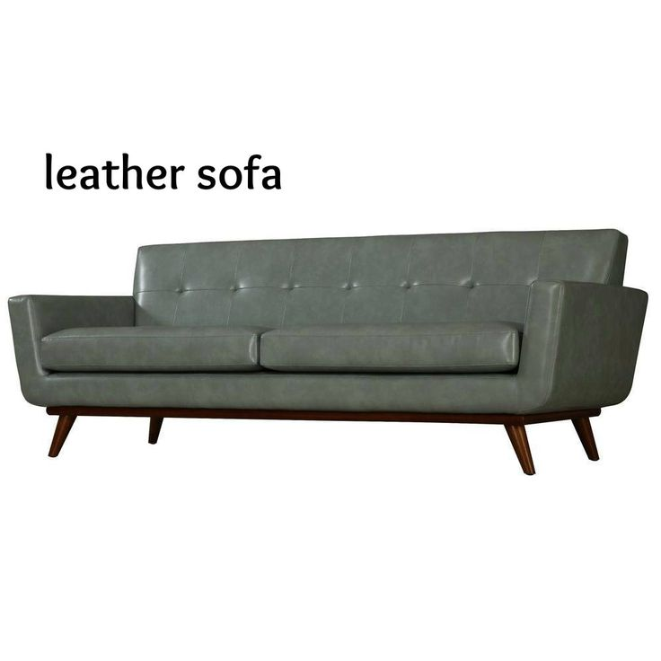 This Mid Century Modern Sofa Features Cushioned Arms For