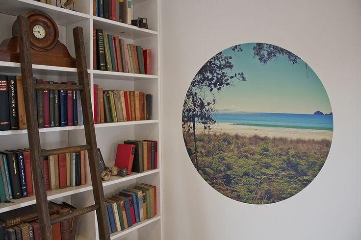 One of our circle decals stuck on a wall in a country library.  Looks like a window to the beach, rather than a paddock!  Available at www.moonstamps.com
