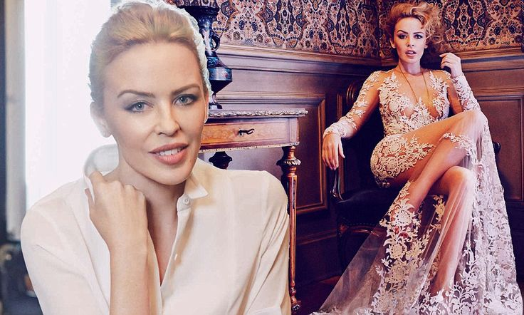 Kylie Minogue stuns in a sheer laced trailing gown for Vogue Australia