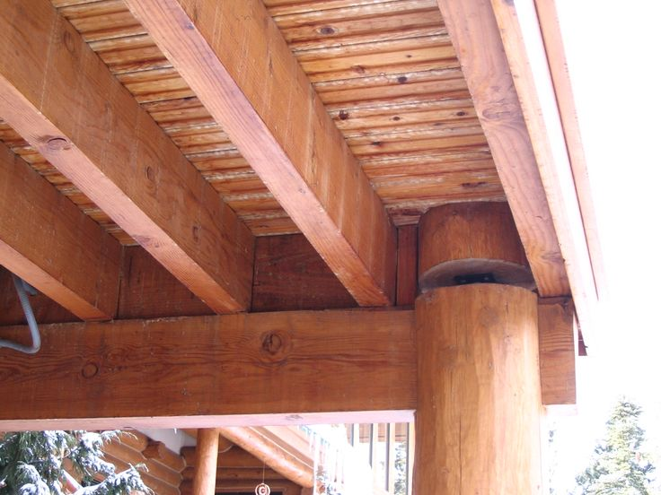 Underside of deck showing vertical post settling jack for Balcony underside