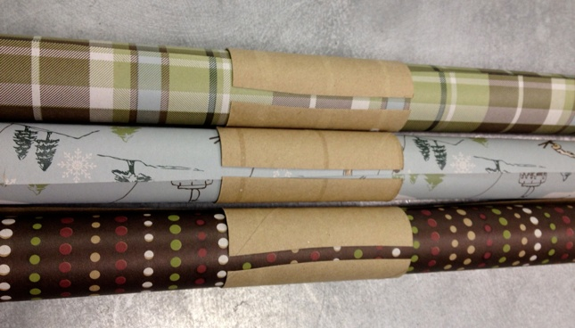 TP or paper towel rolls for controlling rolls of wrapping paper. Great idea