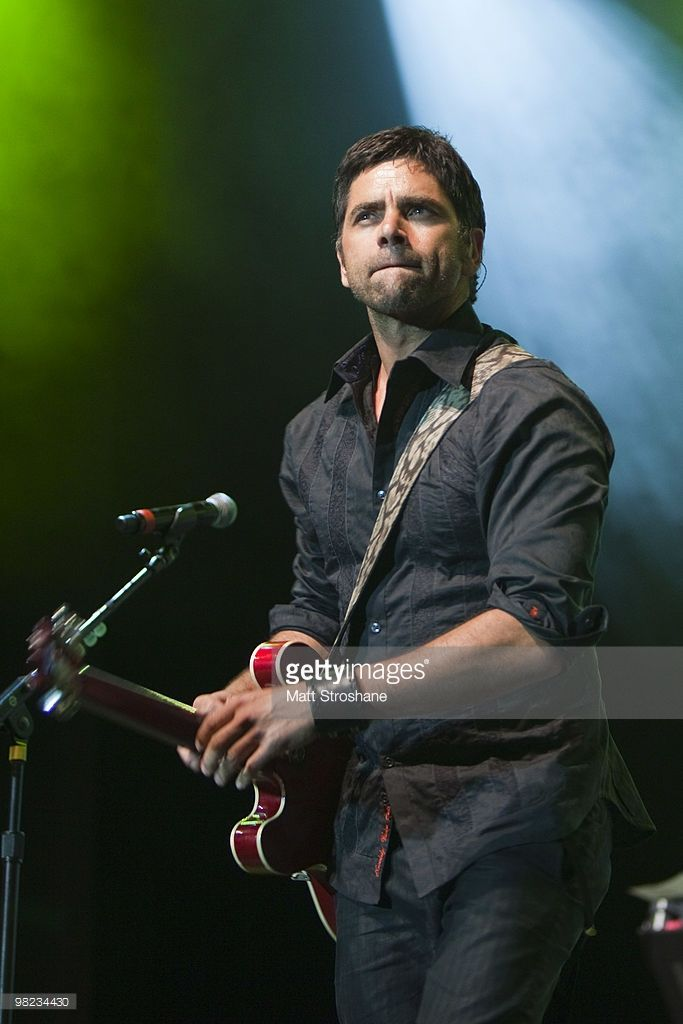 John Stamos performs with the Beach Boys at Universal Studios on April 3, 2010, in Orlando, Florida. The Beach Boys were performing as part of the Mardi Gras concert series.