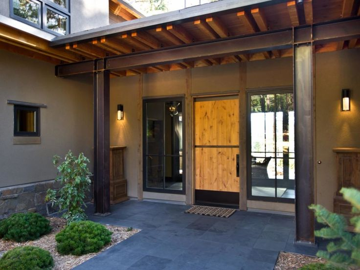 Exterior, : Charming Contemporary Front Porch Decoration Using Single Solid Pine Wood Exterior Door Including Grey Stone Tile Front Porch Flooring And Modern Square Black Outdoor Wall Sconces