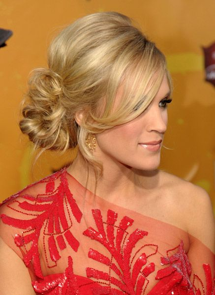 Carrie Underwood - wispy side bun   This turned out to be my bridal hair and it was gorgeous! The link has this style at so many angles it was easy to show my stylist how I wanted it.