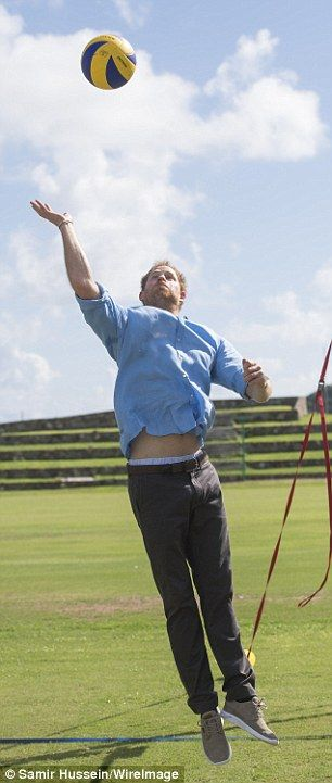 Ready to impress: The sporty royal showed off his midriff as he launched himself at the ba...