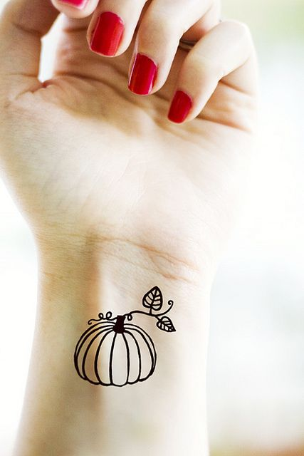 pumpkin Tattoo... Our Grandma Moffa used to call us all her little pumpkins so make it smaller and keep no color other than the number pumpkin that we all are...LOVE IT