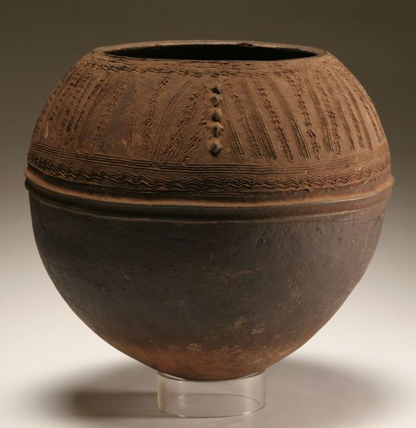 "African Nupe finely engraved ceramic pot, Nigeria, circa 1970. 13 1/2""H."