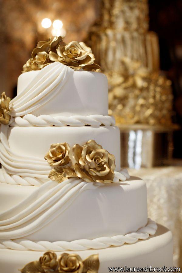 .White and Gold Wedding Reception. Gold Rose White Draping Wedding Cake