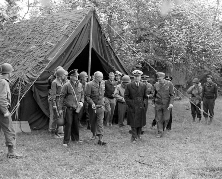 Supreme Allied Commander Dwight Eisenhower touring the Normandy invasion beaches with General George Marshall, Admiral Ernest King, General Arnold and General Bradley, june 12 1944.
