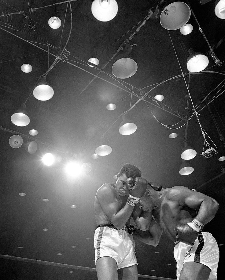 In This Feb. 25, 1964, Sonny Liston, Right, Lowers His Head And Works In Close During The Sixth Round Of Heavyweight Championship Fight Against Muhammad Ali In Miami Beach